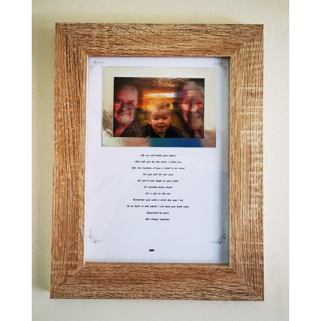 Photo frame with a photo of a young boy with an elderly couple on a sunset background, mounted on silver with a verse written underneath it