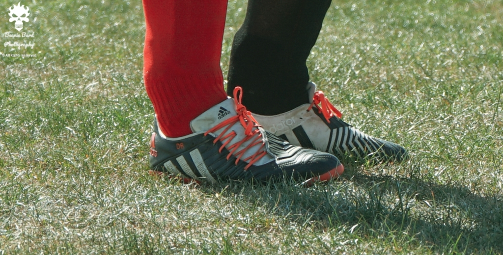 Image of a pair of feet in football boots and socks