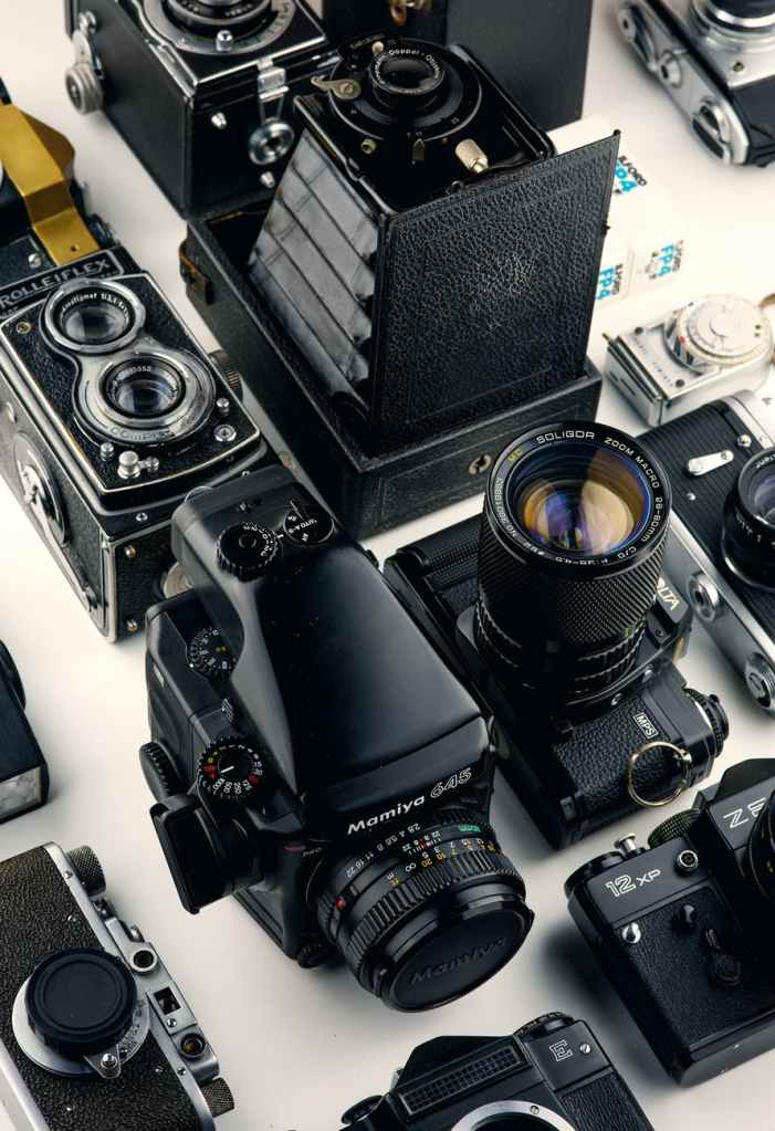 Stock image of a variety of vintage and modern cameras