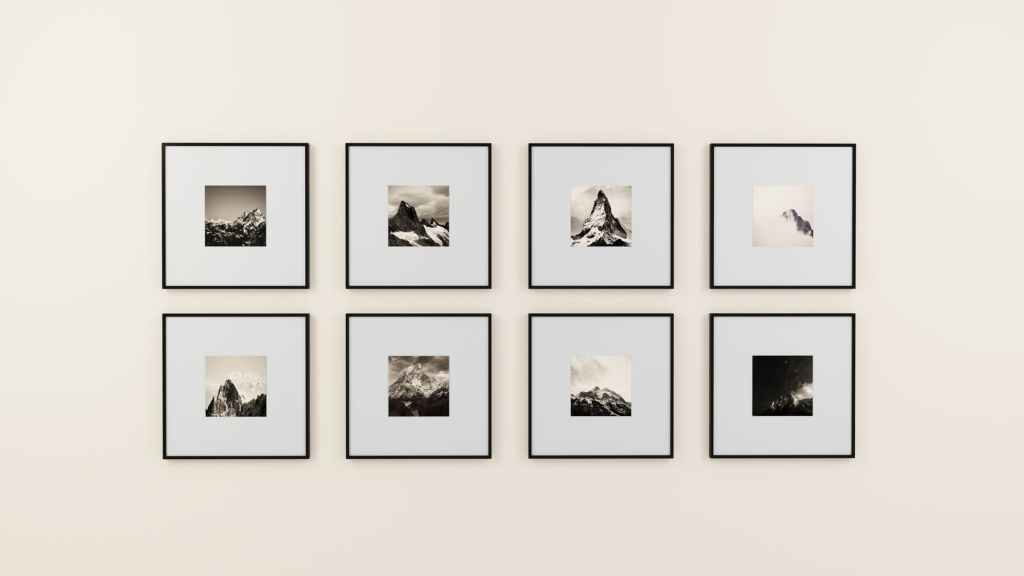 Stock image of a wall of framed photographs